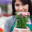 Woman smelling the flower — Stock Photo