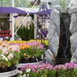 Fake waterfall in garden center — Stock Photo
