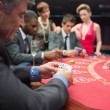 Playing at the poker table — Stock Photo