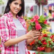 Smiling woman holding a flower — Stock Photo #23088272