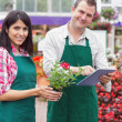 Happy workers with tablet pc in garden center — Foto Stock