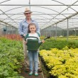 Gardener and little girl holding a watering can - Foto de Stock