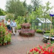 Garden center with couple walking through - ストック写真
