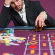 Man looking dejected at roulette table - ストック写真