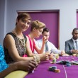 Womsmiling sitting at poker table — Stock Photo #23088600