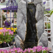 Artificial waterfall in garden center - Stock Photo