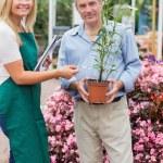 Florist giving advice to customer — Stock Photo #23088754