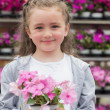 Stock Photo: Little girl holding a plant