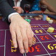 Stock Photo: Mplacing bet on roulette