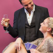 Two flirting at poker table — Stockfoto #23089458