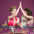 Women high fiving at roulette table — Stock Photo #23089632