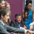 Women watching men placing bets — Stock Photo #23089698