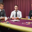 Men looking up from high stakes poker game — Stock Photo #23089784