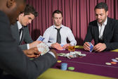 Men playing high stakes poker game — Stock Photo