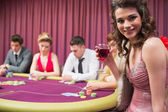 Woman smiling at poker table — Stock Photo