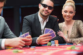 Couple at the poker table — Stockfoto