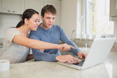 Young couple seeing something interesting on laptop — Stock Photo