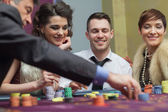 Amused group in a casino — Stock Photo