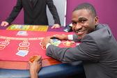 Happy man taking his winnings — Stock Photo