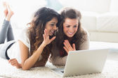 Two women using video chat on laptop — Stock fotografie