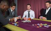 Men playing high stakes game — Stock Photo