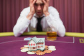 Man is betting his house at poker game — Stock Photo