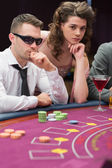 Man and woman at poker table — Stock Photo
