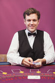 Dealer holding cards in a casino — Stock Photo