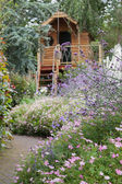 Garden with path and shed — Stock Photo