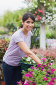 Smiling woman carrying basket — Stock Photo