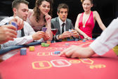 Playing exciting game of poker — Stock Photo