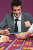 Man happy with his winnings — Stock Photo