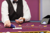 Dealer dealing cards in a casino — Stock Photo