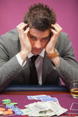 Depressed man in a casino — Stock Photo