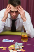 Man betting his house at poker game — Stock Photo
