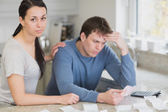 Young couple calculating the finances — Stock Photo