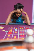 Woman losing at roulette — Stock Photo