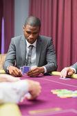 Man looking at his cards — Stock Photo