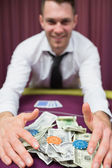 Happy man grabbing his winnings — Stock Photo
