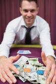 Happy man grabbing his winnings — Stock Photo