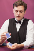 Dealer in a casino shuffling cards — Stock Photo