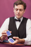 Dealer shuffling cards in a casino — Stock Photo