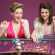 Women winning at roulette - Stock Photo