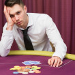 Mlooking worried at poker table — Stock Photo #23090144