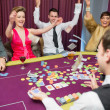 Celebrating at poker game — Stock Photo