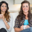 Two women holding cups of coffee — Stock Photo #23090396