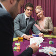 Couple playing poker and smiling — Stock Photo #23090434