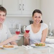 Young couple enjoying their meal — Stock Photo #23090468