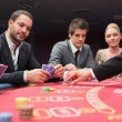 People playing poker at the table - Foto de Stock