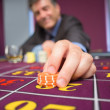 Stock Photo: Mplacing roulette bet